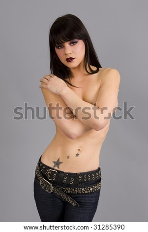Beautiful exotic woman with colorful tattoo - stock photo