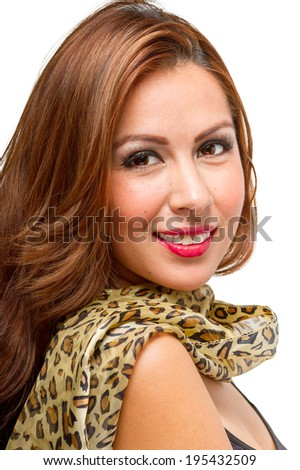 Beautiful exotic young brunette female wearing leopard print scarf - stock photo