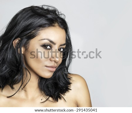 Beautiful exotic young woman head and shoulders - stock photo