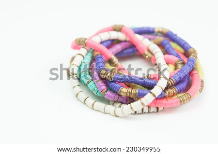 Beautiful expensive bracelets and ring on white background - stock photo
