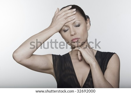 beautiful expressing woman portrait on siolated background confused headache hangover - stock photo