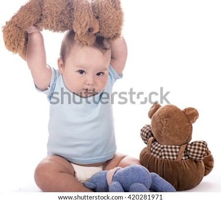 Beautiful expressive adorable happy cute laughing  baby infant face. New born during tummy time with toy bear - stock photo