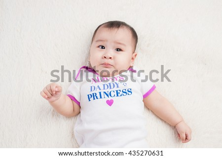 Beautiful expressive adorable happy cute laughing smiling asian baby infant face - stock photo