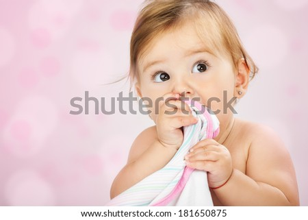 Beautiful expressive adorable happy cute laughing smiling baby infant face. Studio shot. - stock photo