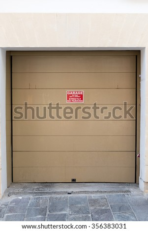 beautiful Exterior Garage Door architecture made from wood protecting the cars people store inside in Valletta Malta / Garage Doors 8 - stock photo