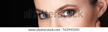 Beautiful eyes of Adult Woman with Clean Fresh Skin close up view. Beauty Portrait.  Pure Beauty Model.