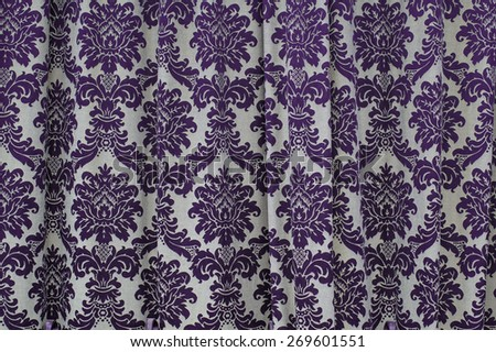 Beautiful fabric texture curtains with vintage pattern. - stock photo