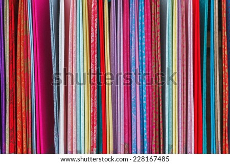 Beautiful fabrics are sold in the market of Xingping - China