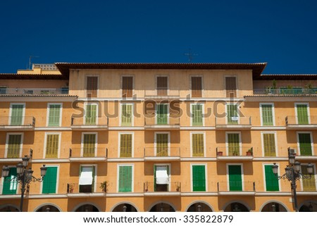 Beautiful facade of the famous Plaza Major in Palma de Mallorca, Spain. Building in classical style with big windows and balconies. Landmarks of Spain. - stock photo