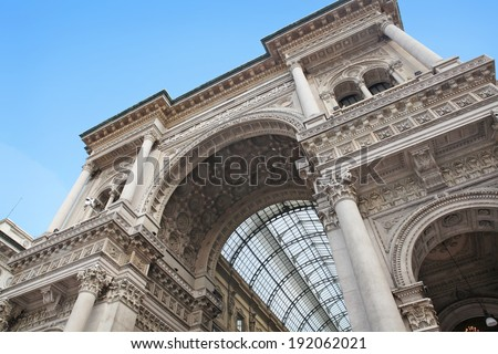 Beautiful facade of the 19th century Galleria Vittorio Emanule II, famous shopping mall in Milan, Italy. - stock photo
