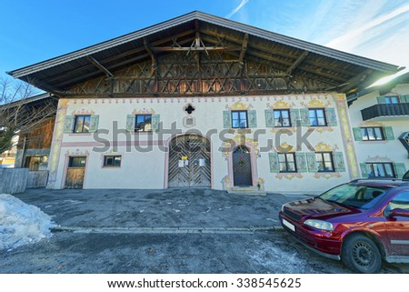 Beautiful facade painting on the house in Garmisch-Partenkirchen, Germany. The Bavarians have a long history of decorating the exteriors of their houses with religious and historic paintings - stock photo