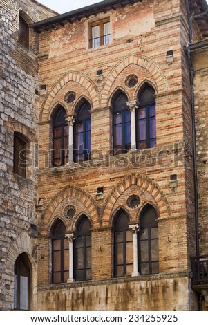 Beautiful facades in Italy, different ages - stock photo