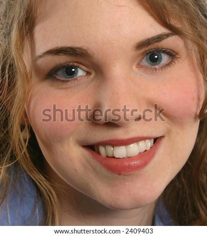 Beautiful face, female, blue eyes, smile - stock photo