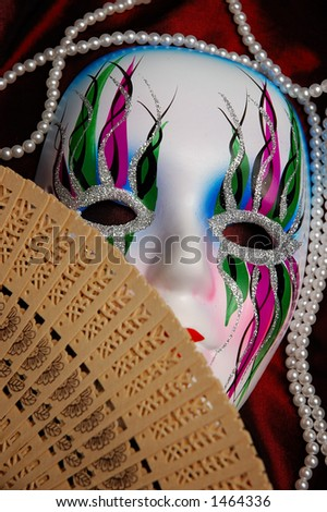 Beautiful face in mask covered with fan expressive artistic concept - stock photo