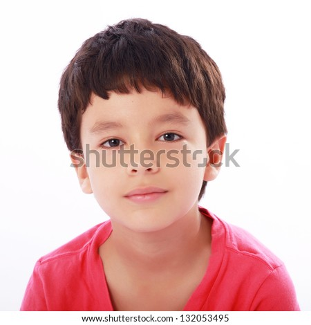 beautiful face of a child looking at the camera - stock photo