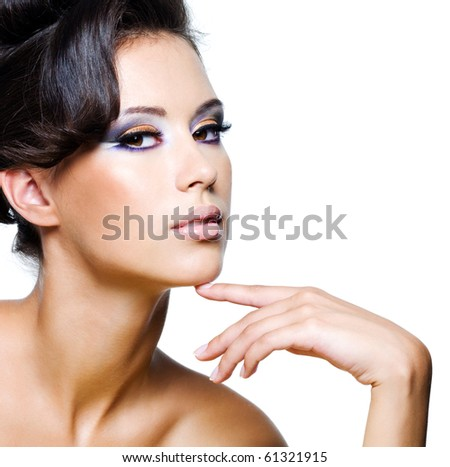 Beautiful face of a glamour woman with modern brightly makeup - stock photo