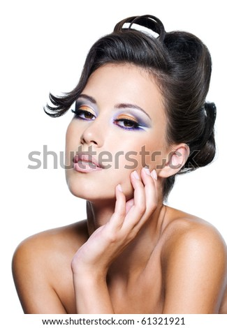 Beautiful face of a glamour woman with modern curly hairstyle and brightly makeup - stock photo