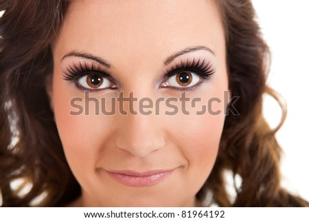 beautiful face of a glamour woman with modern curly hairstyle and brightly makeup, isolated on white background - stock photo