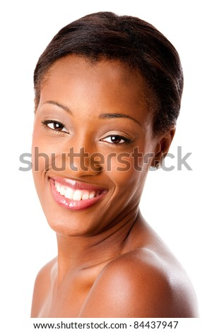 Beautiful face of a happy attractive African young woman smiling with healthy pimple acne free skin and white teeth, skincare or dental care concept, isolated. - stock photo