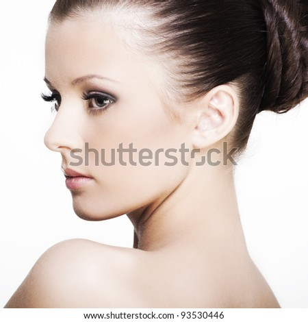 beautiful face of a woman with perfect skin and beautiful eyes on a white background - stock photo