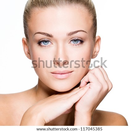 Beautiful face of a young caucasian woman - isolated on white - stock photo