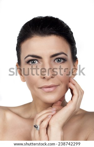 Beautiful face of adult woman with clean fresh skin - isolated on white  - stock photo