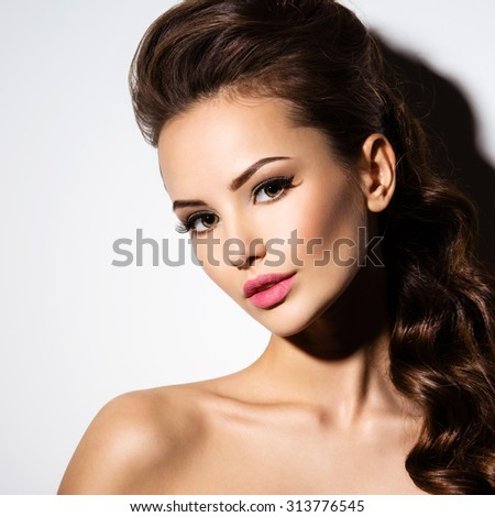 Beautiful face of an young sexy woman posing at studio on white background - stock photo