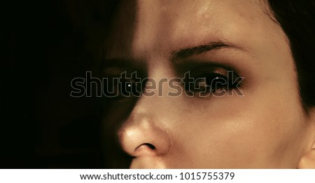 Beautiful face of crying and  suffering young woman.  Eyes with tears. Emotional pain,abuse, despair and fear concept. Photo is philtered.
