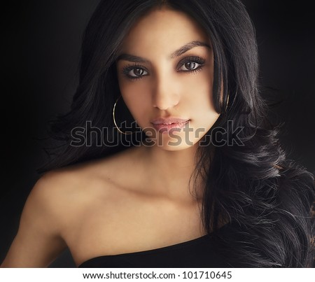 Beautiful face of dark haired young woman - stock photo