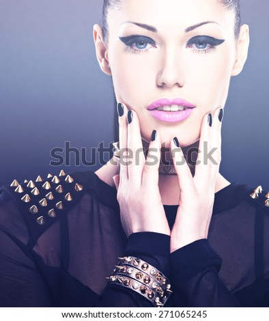 Beautiful face of fashion woman with black nails and bright makeup.  Sexy stylish girl with bracelet thorns on the neck - stock photo