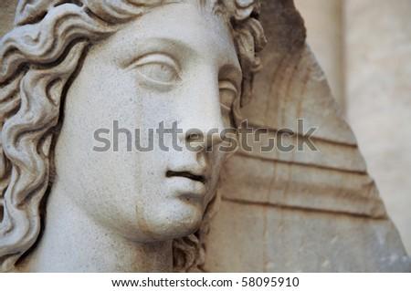 beautiful face of Roman statue - stock photo