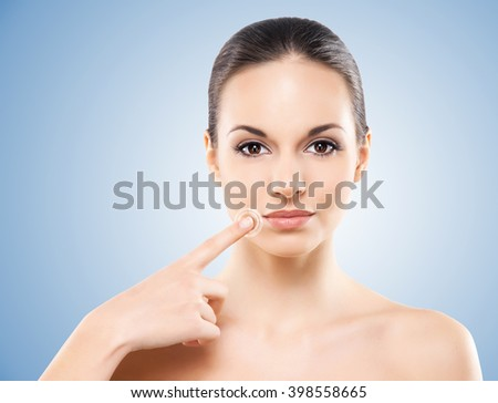 Beautiful face of the healthy and natural girl - stock photo