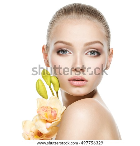 Beautiful face of the  healthy young woman with flowers  - isolated on white