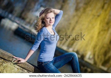 Beautiful face of the young sexy woman posing near  on nature - stock photo