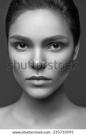 Beautiful face of young adult caucasian woman with clean fresh skin and natural make-up. Black and white photo - stock photo