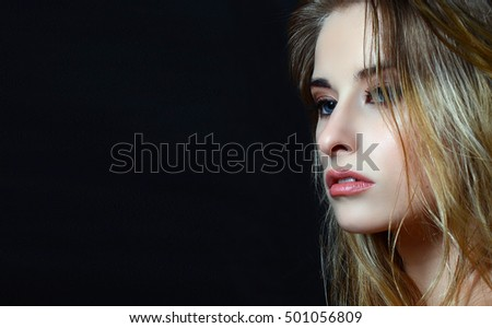 Beautiful face of young adult woman with clean fresh skin and wet hair