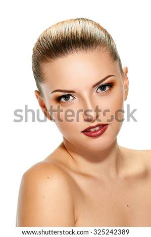 Beautiful face of young adult woman with clean fresh skin on white - stock photo
