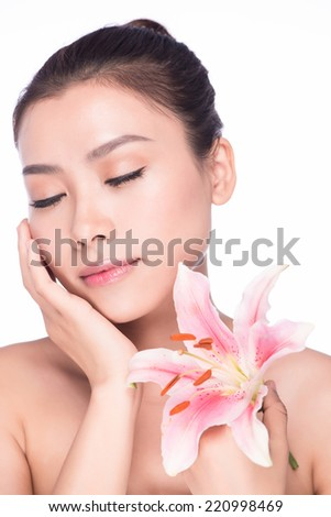 beautiful face of young adult woman with pink lily flowes, asian beauty model