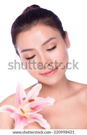 beautiful face of young adult woman with pink orchids, asian - stock photo