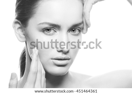 Beautiful face of young caucasian brunette woman with natural lips, make-up and blue eyes isolated on white.