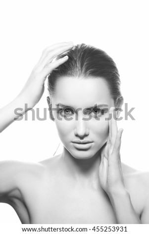 Beautiful face of young caucasian brunette woman with natural lips, make-up and blue eyes isolated on white. Black and white - stock photo