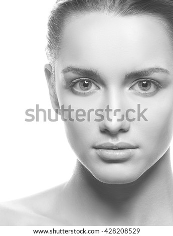 Beautiful face of young caucasian woman brunette with natural make-up, perfect skin and blue eyes isolated on white. Studio portrait. Black and white - stock photo