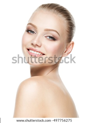 Beautiful face of young smiling woman with clean fresh skin - isolated on white