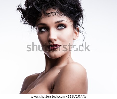 Beautiful face of young stylish woman on white background.