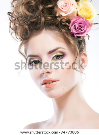 Beautiful face of young woman, clean skin. Beauty girl - long curly brown hair with flowers and bright  makeup - stock photo
