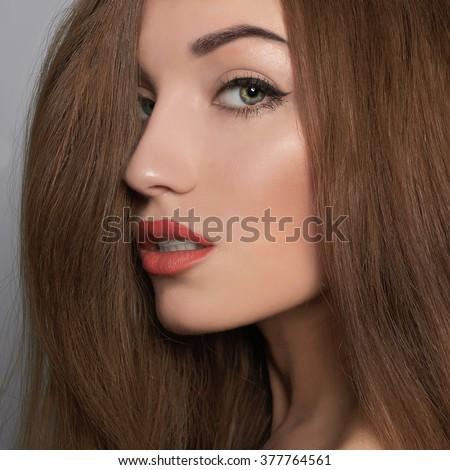 beautiful face of young woman. Healthy hair girl with make-up - stock photo