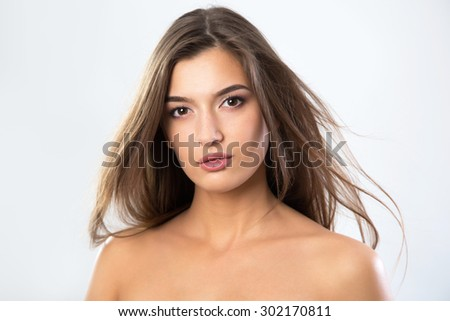 Beautiful face of young woman with clean fresh skin - stock photo