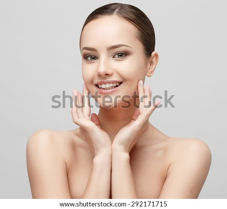 Beautiful Face of Young Woman with Clean Fresh Skin close up isolated on white. Beauty Portrait. Beautiful Spa Woman Smiling. Perfect Fresh Skin. Pure Beauty Model. Youth and Skin Care Concept - stock photo