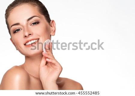 Beautiful Face of Young Woman with Clean Fresh Skin close up isolated on white. Beauty Portrait. Beautiful Spa Woman Smiling. Perfect Fresh Skin. Pure Beauty Model. Care Concept. cotton pad near face - stock photo