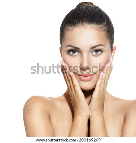 Beautiful Face of Young Woman with Clean Fresh Skin isolated on white. Beauty Girl touching her face. Beautiful Spa Woman Smiling. Perfect Fresh Skin. Pure Beauty Model. Youth and Skin Care Concept  - stock photo